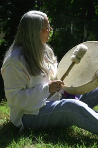 Laura Drumming at a Women's Retreat.